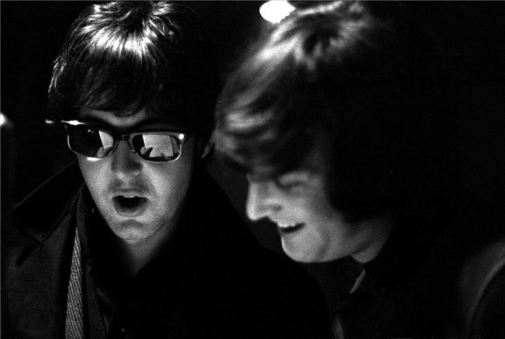 Paul and John,  Paul in dark glasses, John smiling