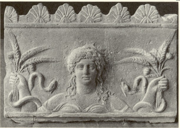 Carving of the goddess Ceres with poppies, shafts of wheat and snakes