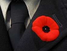 Red poppy on lapel
